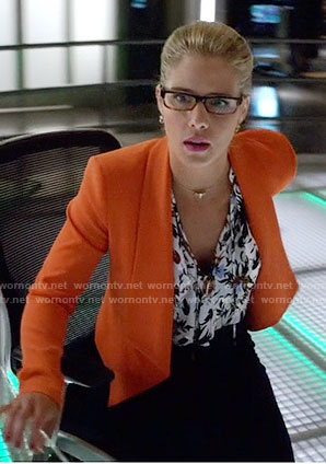 Felicity's floral top and orange jacket on Arrow