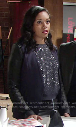 Hilary's navy blazer with leather sleeves and embellished top on The Young and the Restless