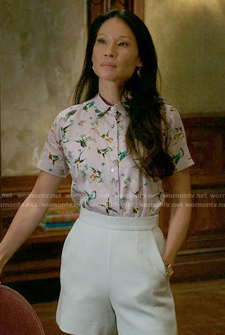 Joan's bird print shirt and mint shorts on Elementary