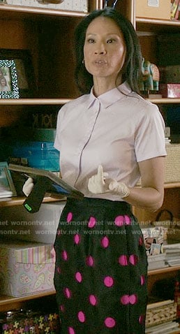 Joan's black and pink polka dot skirt on Elementary