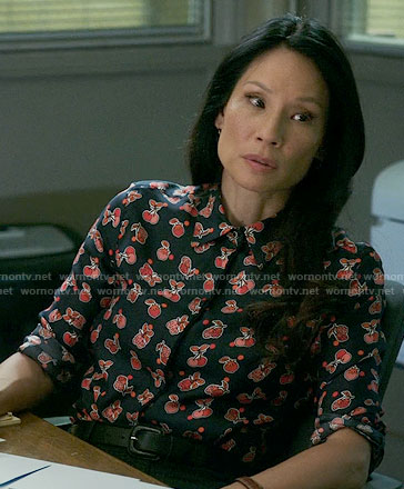 Joan's navy and red fruit print shirt on Elementary