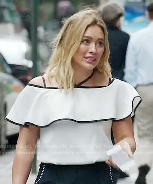 Kelsey's white ruffled off-shoulder top on Younger