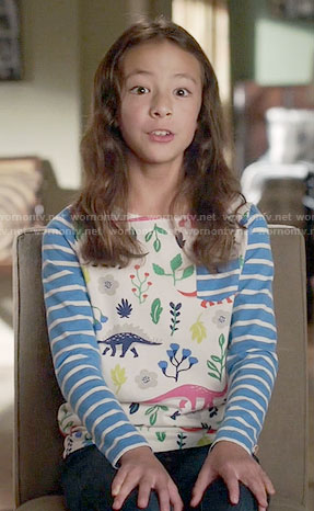 Lily's dinosaur print top with striped sleeves on Modern Family