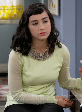 Mandy's lime sweater with cutout back on Last Man Standing