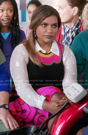 Mindy's pink scalloped print top and metallic patterned shirt on The Mindy Project
