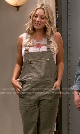 Penny's floral peace sign top and green overalls on The Big Bang Theory
