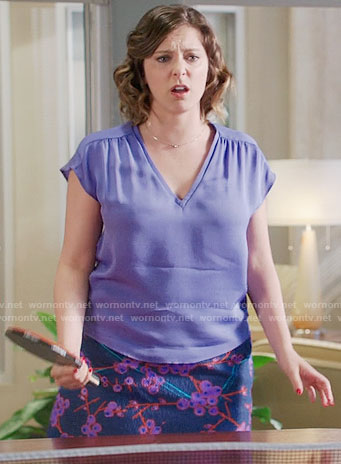 Rebecca's purple v-neck top and printed skirt on Crazy Ex-Girlfriend