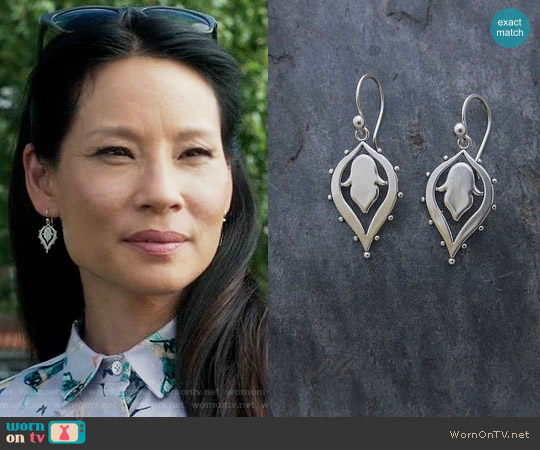 Sasha Bell Jewelry Lotus Drop Earrings worn by Joan Watson on Elementary