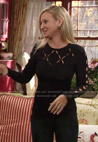 Sharon's navy long sleeved top with cutouts on The Young and the Restless