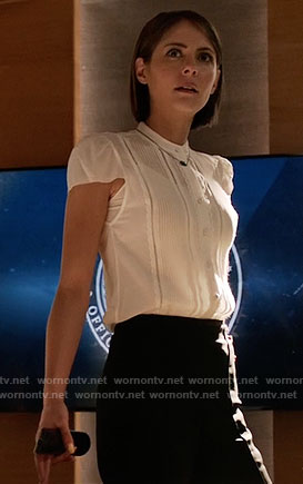 Thea's white pintuck top and turquoise necklace on Arrow
