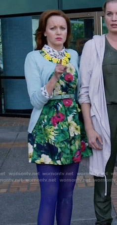 Cassandra's green floral dress and blue cardigan on The Librarians