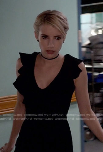 Chanel's black ruffled jumpsuit on Scream Queens