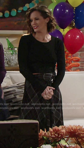 Chelsea's black cutout top and plaid skirt on The Young and the Restless