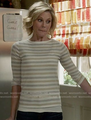 Claire's grey and beige striped sweater on Modern Family