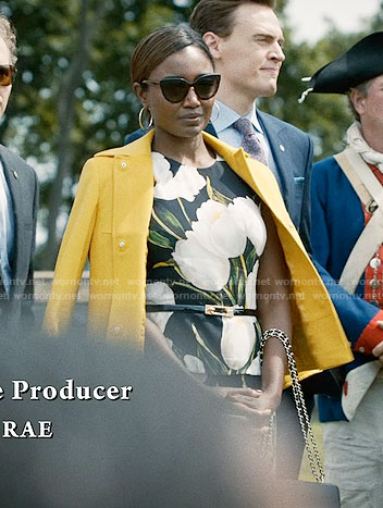 Daisy's tulip print dress and yellow jacket on Madam Secretary