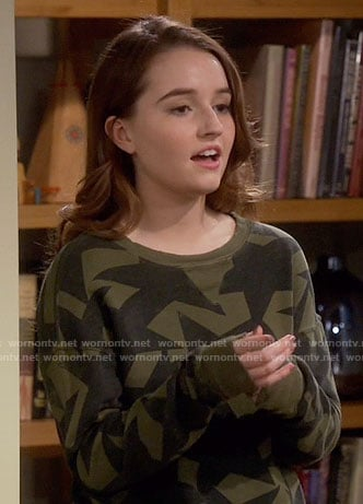 Eve's green star print sweatshirt on Last Man Standing