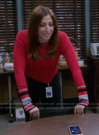 Gina's red sweater with striped cuffs on Brooklyn Nine-Nine