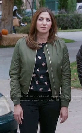Gina's black bird print top and green bomber jacket on Brooklyn Nine-Nine