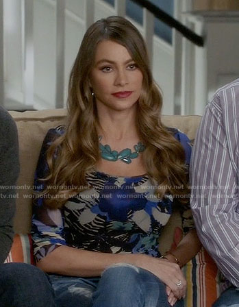 Gloria's blue floral print long sleeve top on Modern Family