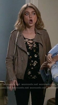 Haley's floral cross strap top and suede jacket on Modern Family