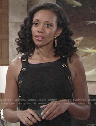 Hilary's black top with gold grommet straps on The Young and the Restless