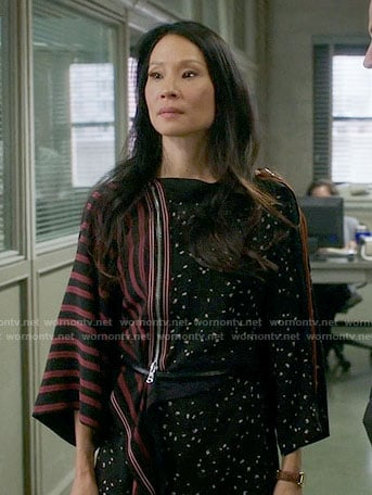 Joan's black dotted print dress with striped sleeve on Elementary