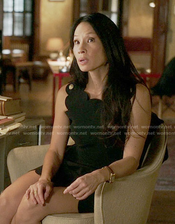 Joan's black scalloped trim dress on Elementary