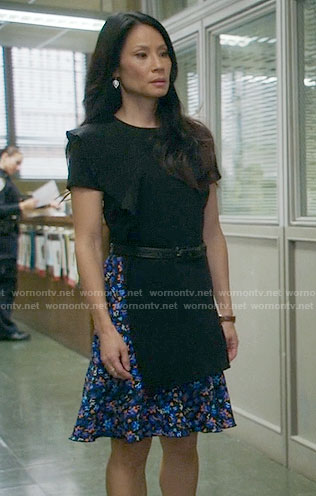Joan's blue floral dress with black overlay on Elementary