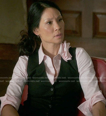 Joan's pink shirt with bow collar on Elementary