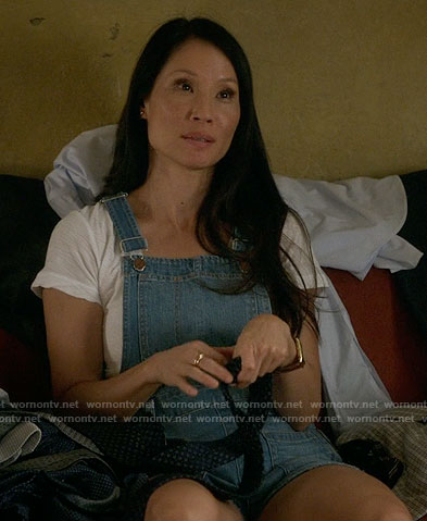 Joan's short denim overalls on Elementary