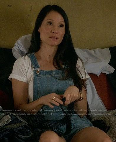 Joan's short denim overalls on Elementary
