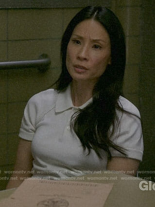 Joan's white knit polo top on Elementary
