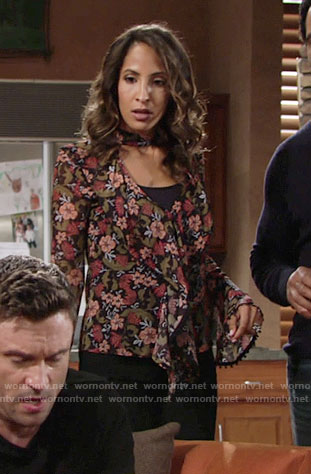 Lily's floral ruffled blouse on The Young and the Restless