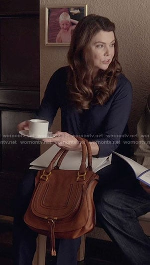 Lorelai's tan handbag on Gilmore Girls: A Year in the Life
