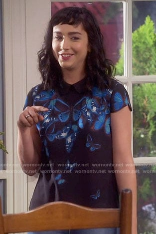 Mandy's blue butterfly print top on Last Man Standing
