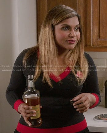 Mindy's navy sweater with red trim and rose embroidery on The Mindy Project
