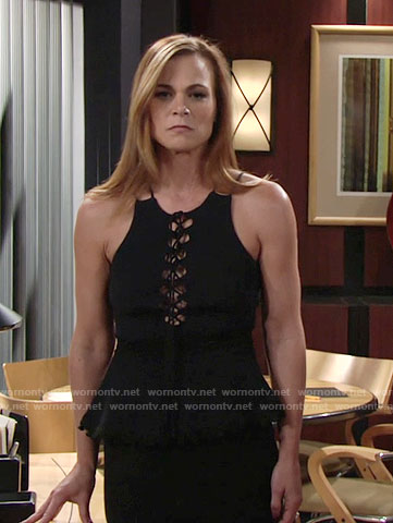 Phyllis's navy lace-up peplum top on The Young and the Restless