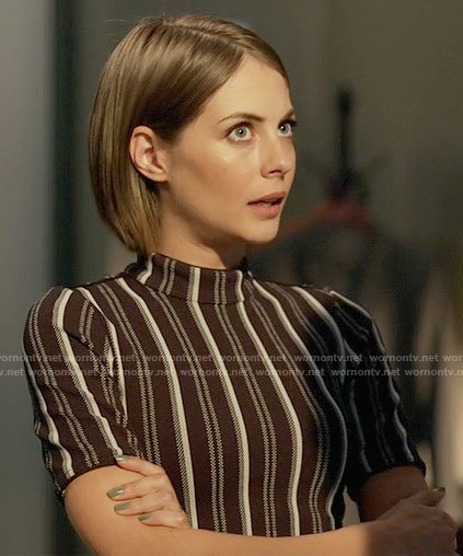 Thea's black striped mock-neck top on Arrow