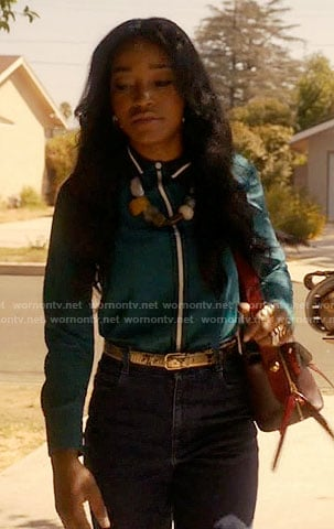 Zayday's teal green shirt with white trim on Scream Queens