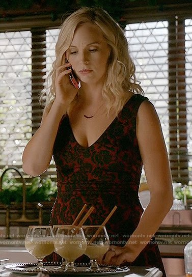 Caroline's red and black floral Christmas dress on The Vampire Diaries