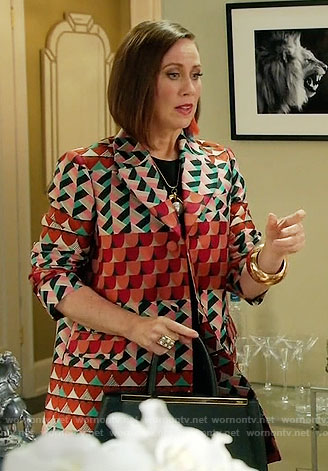 Diana's geometric print coat on Younger