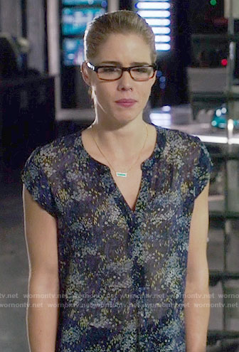 Felicity's navy floral split-neck top on Arrow