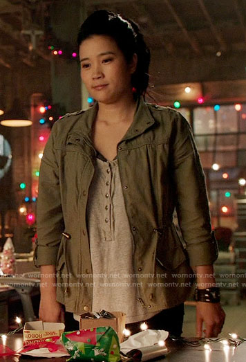 Happy's grey henley top and green jacket on Scorpion