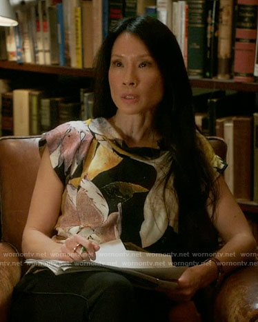 Joan's printed top on Elementary