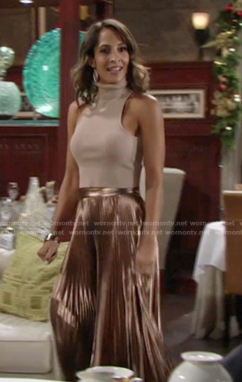 Lily's gold pleated skirt and metallic crop top on The Young and the Restless