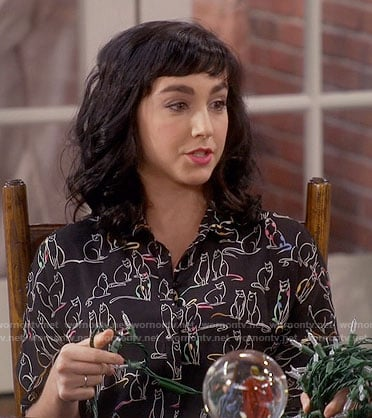 Mandy's black cat print top on Last Man Standing