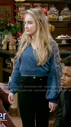 Maya's blue cropped sweater with embroidered sleeves on Girl Meets World