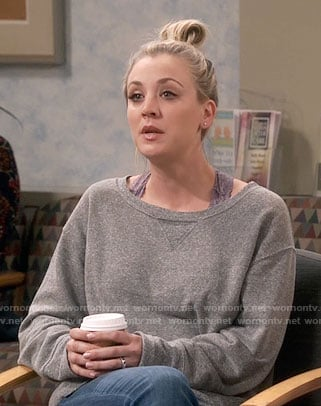Penny's grey sweatshirt and purple lace bra on The Big Bang Theory