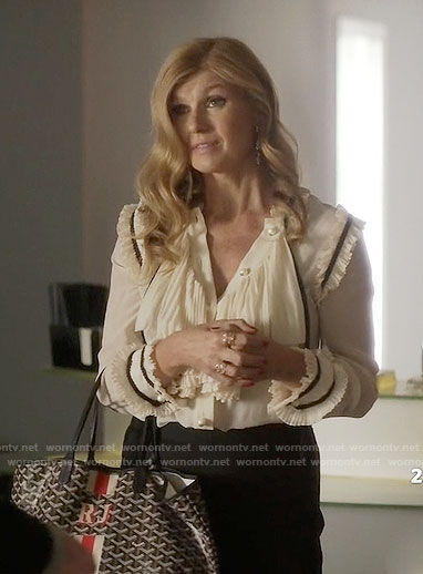 Rayna's crema ruffled blouse with pearl buttons on Nashville