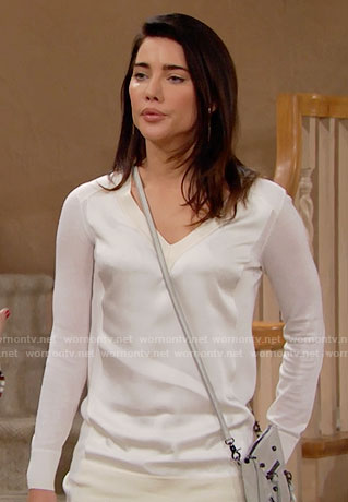 Steffy's white shiny v-neck sweater on The Bold and the Beautiful